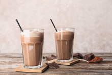 Glasses With Chocolate Milk Shakes On Wooden Table