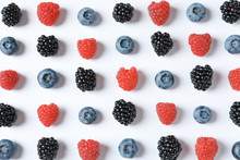 Composition With Raspberries, Blackberries And Blueberries On White Background