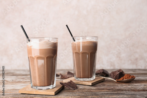 Garden Poster Milkshake Glasses with chocolate milk shakes on wooden table