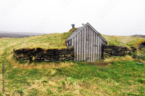 Foto op Canvas Vestingwerk small wooden house for shepherd in Iceland covered with moss