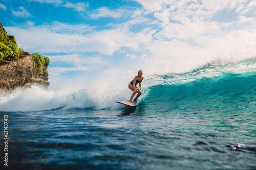 Foto  Surf girl on surfboard