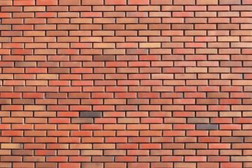 Fototapeta Do steakhouse wall of colored bricks with different step of laying