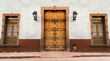 House With Mexican Colonial Facade In Queretaro Mexico, Classic Wood Doors And Decorative Windows.