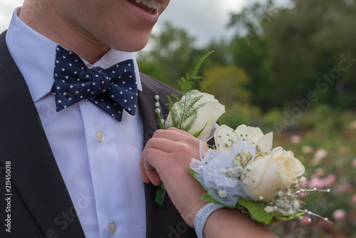 pinning boutonniere and corsage for prom or formal Wallpaper Mural
