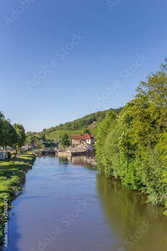 Spoed Foto op Canvas Rivier Fulda river in the historic center of Hann. Munden, Germany