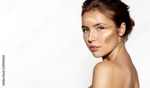 Canvastavla Waist up portrait of sensual young woman with different kinds of foundation on her face