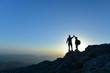 canvas print picture - Couple hikers success concept in mountains