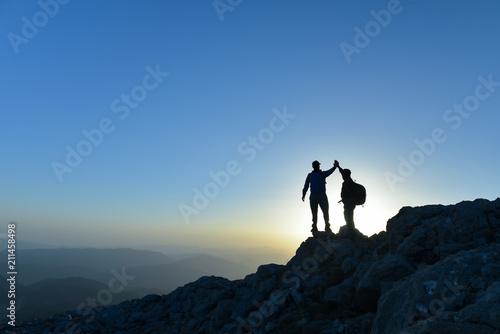 Fotografie, Obraz Couple hikers success concept in mountains