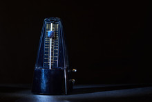 Metronome On A Dark Background