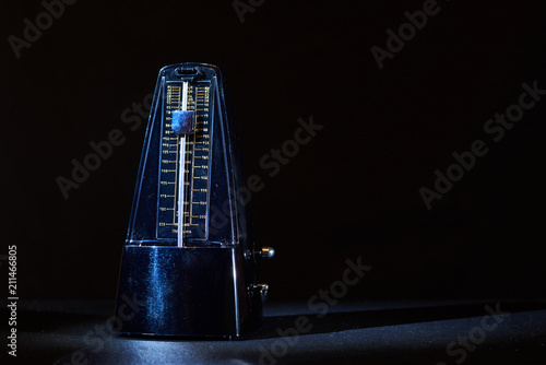 metronome on a dark background Canvas Print