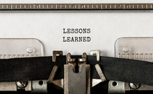Text LESSONS LEARNED Typed On Retro Typewriter