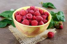 Fresh Ripe Tasty Raspberries In A Yellow Ceramic Bowl. Summer Berries.