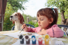 Cute Little Girl Paints Animal...