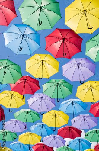 Poster Oranje eclat Colorful umbrellas in the sky
