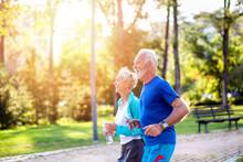Happy Senior Couple Jogging Ou...