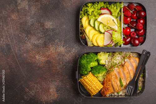 Foto op Canvas Assortiment Healthy meal prep containers with grilled chicken with fruits, berries, rice and vegetables. Takeaway food, copy space