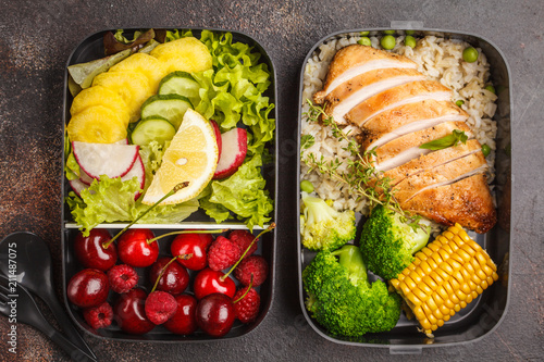 Healthy meal prep containers with grilled chicken with fruits, berries, rice and vegetables. Takeaway food.