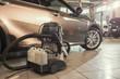 vacuum cleaner/ Professional vacuum cleaner for car chemist in a car workshop