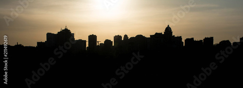 Fototapety, obrazy: Silhouette of the city at sunset