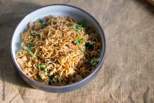 Stir fried instant noodle with mixed vegetable and pork
