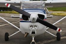 Symmetrical Front View Of Cessna 172 Skyhawk 2 Airplane On An Asphalt Runway.