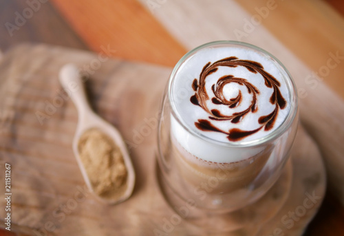 Fotografie, Obraz  Hot mocha coffee latte art chocolate heart shape spiral glass on table backgroun