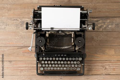 Fotobehang Retro Top view of retro style typewriter in studio