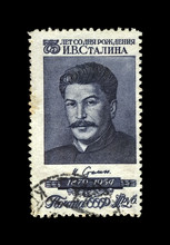 Joseph Stalin, Famous Soviet Politician Leader, 75th Birth Anniversary, Circa 1954.. Vintage Canceled Postal Stamp Printed In USSR (Soviet Union) Isolated On Black Background.