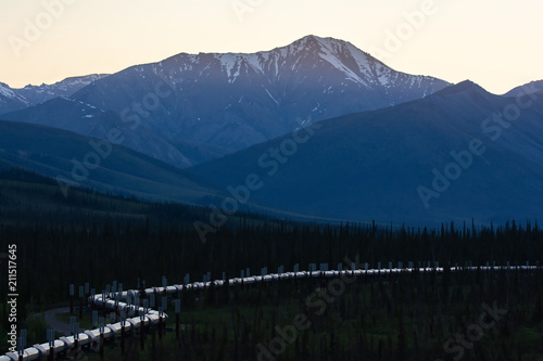 Fototapeta Alaskan pipeline snakes through valley obraz