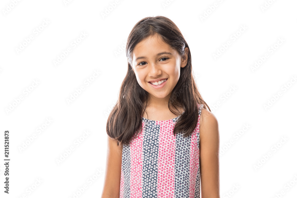 Fototapeta Smiling young hispanic girl posing and looking at the camera over white background
