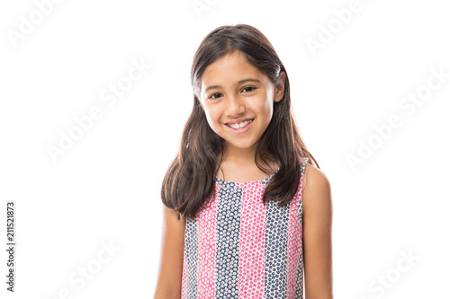 Smiling young hispanic girl posing and looking at the camera over white backgrou Canvas Print
