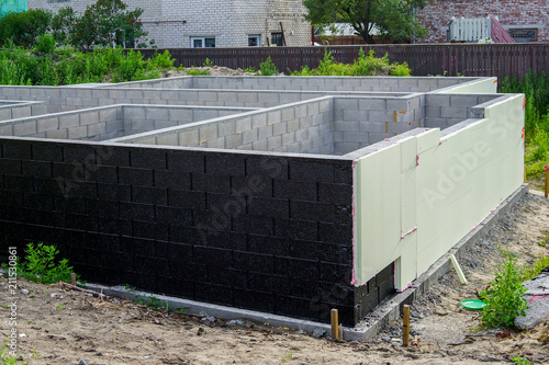 Fotomural Concrete foundation of a new house, thermal insulation
