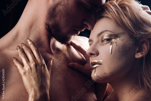 Gold Makeup Of Woman Embrace Man Gold Makeup Or Body Art Buy This Stock Photo And Explore Similar Images At Adobe Stock Adobe Stock