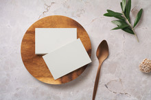 Minimalist Food Or Restaurant Related Branding Mock-up With Stack Of Business Cards On A Wooden Plate