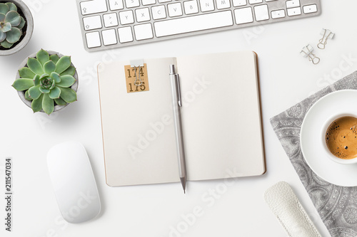 Staande foto Wanddecoratie met eigen foto modern minimalist workspace / desktop with blank open notebook, coffee, office supplies and succulents, top view