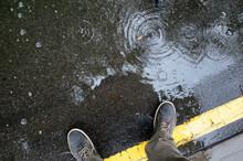 Rainy Weather. Male Legs In Sn...