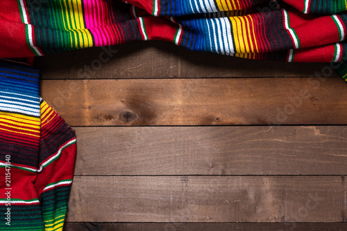 Fotografie, Obraz  A mexican serape blanket on a wooden plank background