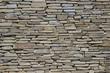 Smooth stonework. Wall of wild stone.