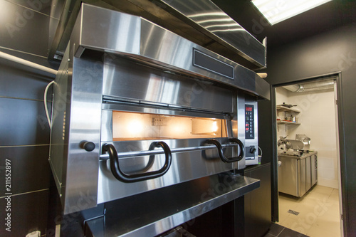 Fototapeta A modern oven for baking pizza in a restaurant obraz