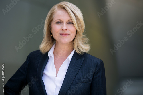 Proud confident headshot of a mature fifties CEO businesswoman investor