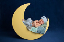 Newborn Boy Sleeping On The Moon