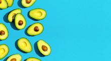 Fresh Avocado Pattern On A Blue Background Flat Lay