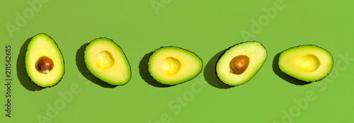 Fresh avocado pattern on a green background flat lay - 211562685