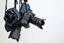 Pile Of Modern DSLR Cameras On White Isolate Background, How To Choose Dslr Camera Concept.