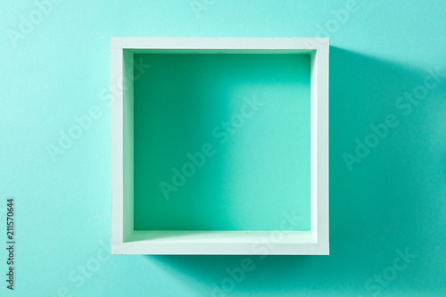 Fotografía  Wall green shelf view isolated on mint background