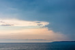Seascape with dramatic sky and clouds on sunset