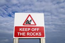 A Danger Sign Saying Keep Off The Rocks, UK