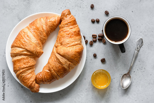 Slika na platnu Croissants, coffee and honey on concrete background