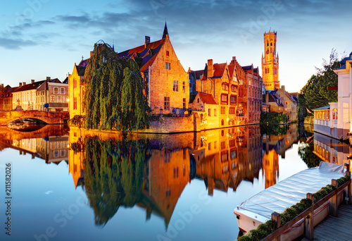 Wall Murals Bridges Belgium - Historical centre of Bruges river view. Old Brugge buildings reflecting in water canal.
