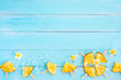 Pineapple popsicle sticks with ice on wood plank blue color. summer fruit concept, top view